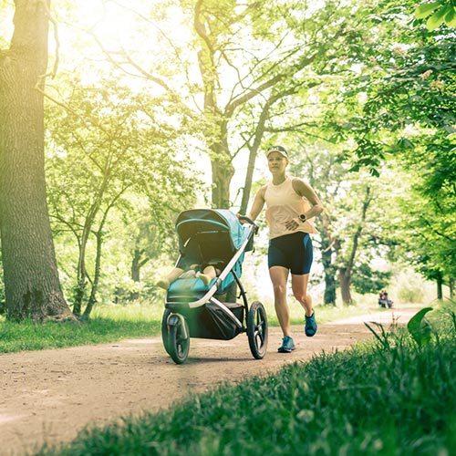 Mum running with stroller