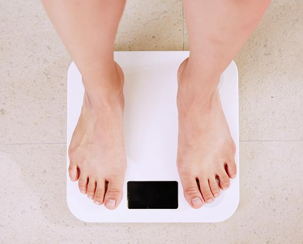 Feet on weight scales