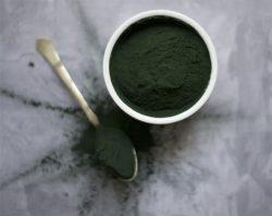 Green powder tub and spoon