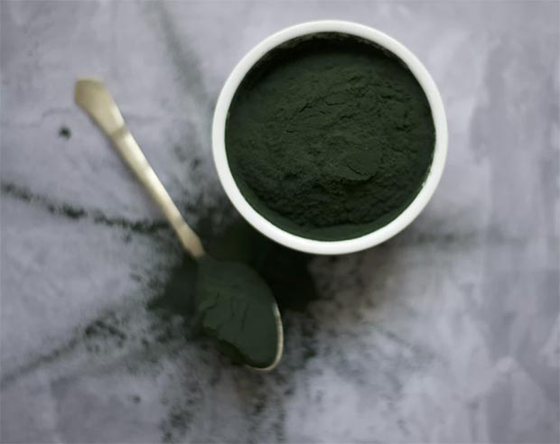 Green powder tub and spoon