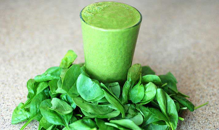 Green smoothie drink with leaves