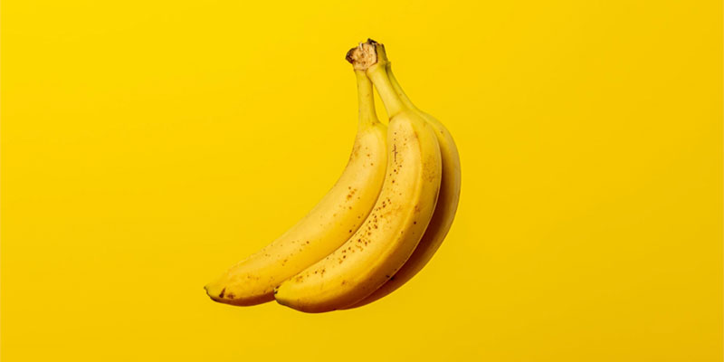 Bananas on yellow background