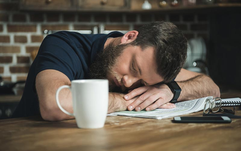 Exhausted guy suffering burnout