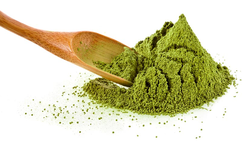 Powdered greens and bamboo spoon