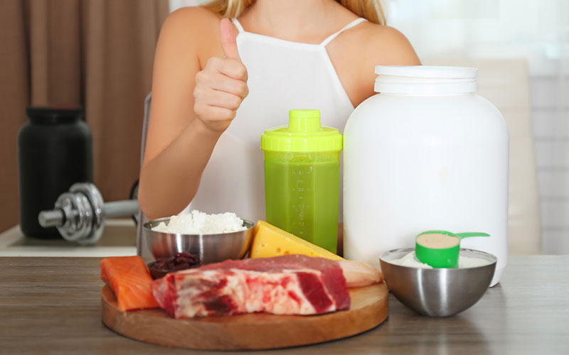 Women with protein and greens shaker