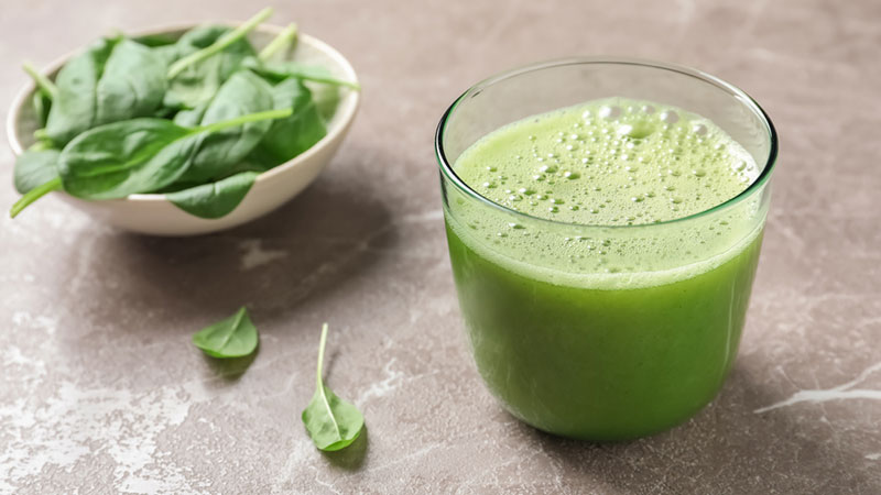 Green smoothie with spinach leaves