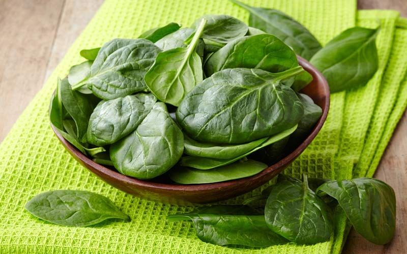 Spinach bowl on green napkin